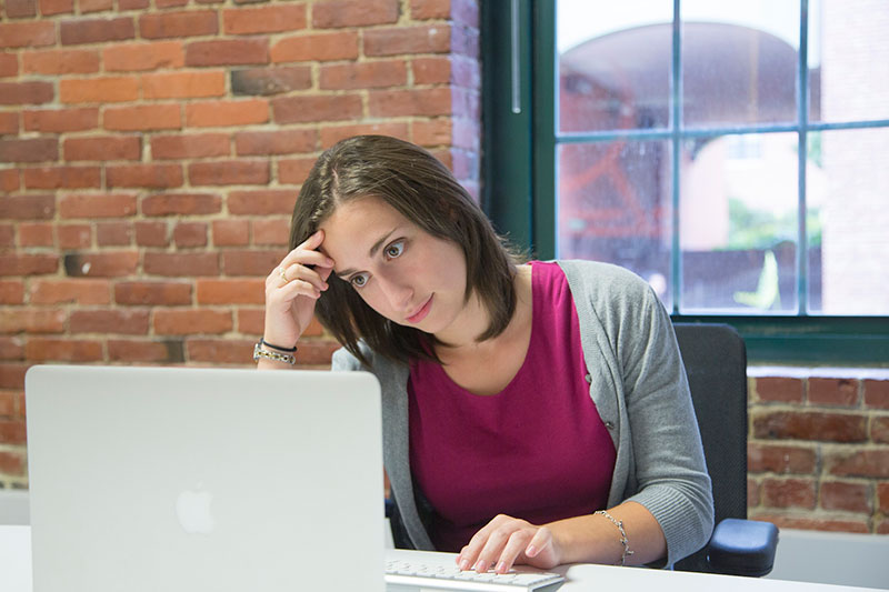 woman frustrated at computer with WordPress 5.0 upgrade